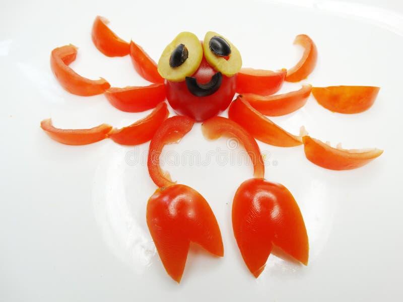 Creatieve grappige plantaardige snack met tomaat stock afbeeldingen