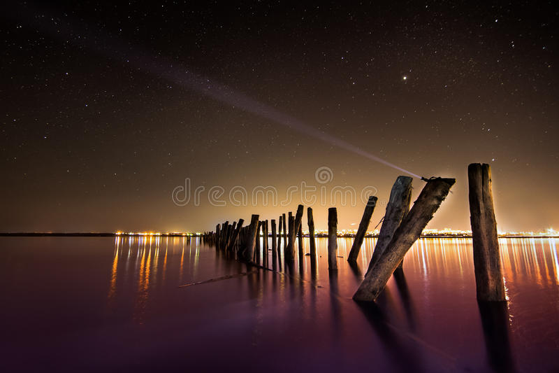 Creating Aurora -unusual pole in the water at night royalty free stock images