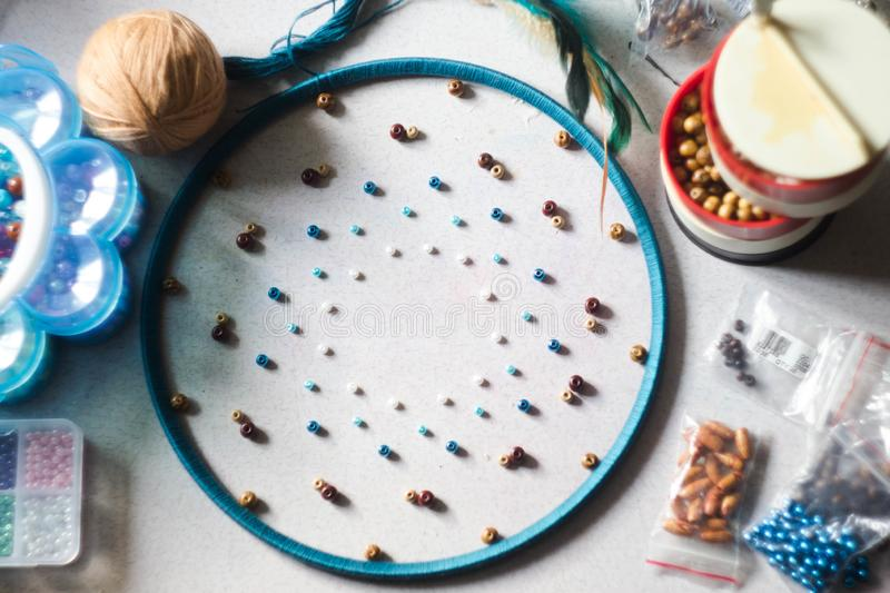 Creating a dream catcher. Everything is ready to create it. Beads, circle, Hoop, feathers stock photography