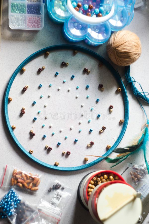 Creating a dream catcher. Everything is ready to create it. Beads, circle, Hoop, feathers royalty free stock image