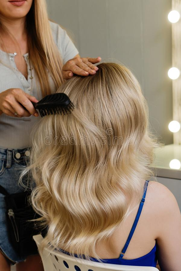 Creating hairstyle royalty free stock images