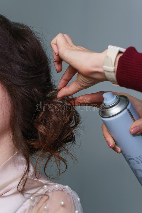 Hairdresser making hairstyle to girl in beauty salon stock photography