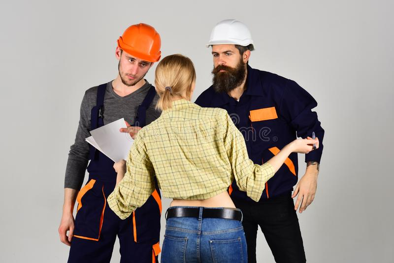 Creating perfection. Construction workers team. Professional people working on construction design. Group of stock images
