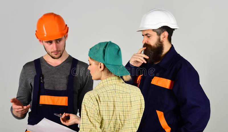 Creating reality. Construction workers team. Men and woman builders working in team. Group of constructing engineers and royalty free stock image