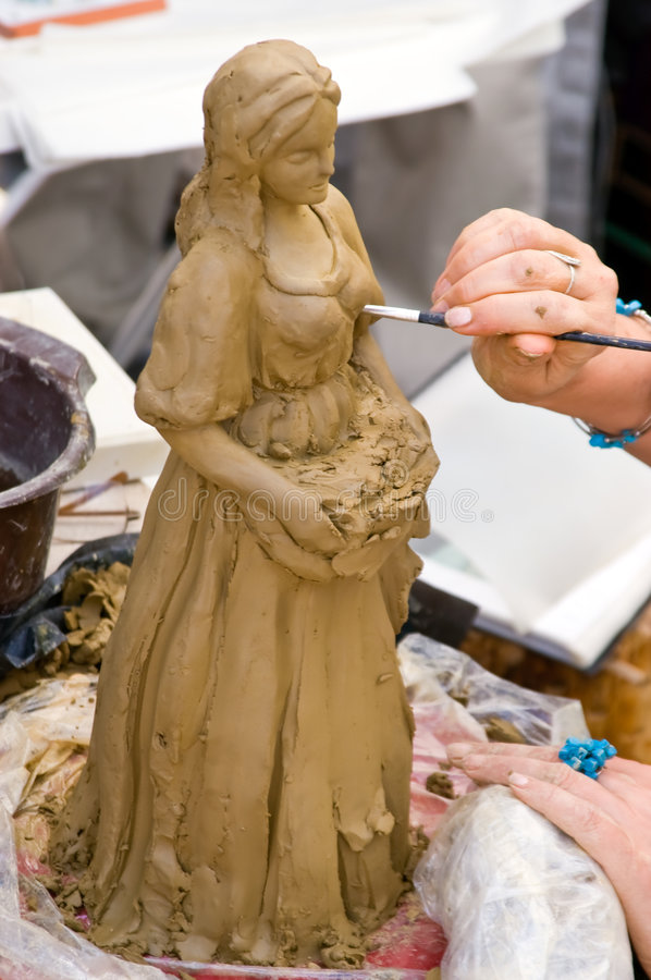 Creating sculpture. Woman artist hands while she is creating a sculpture stock photos