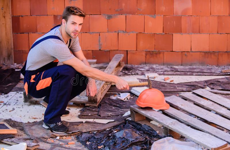 Creating solid foundation. worker brick wall background. building and construction. professional repairman hard hat. man royalty free stock photo
