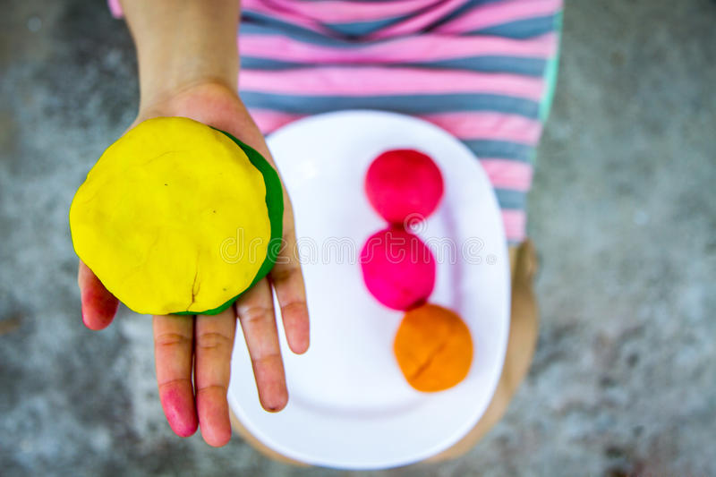 Download Colorful  Play Dough On Hand Royalty Free Stock Image - Image: 29971176