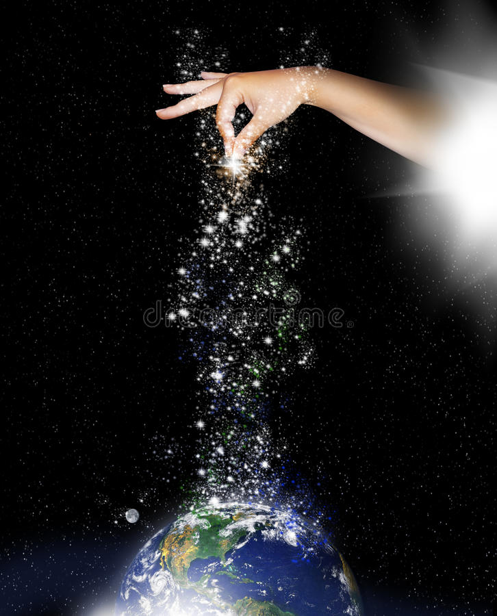 Creation. A hand apears out of a bright white light to sprinkle stars of creation onto the planet
