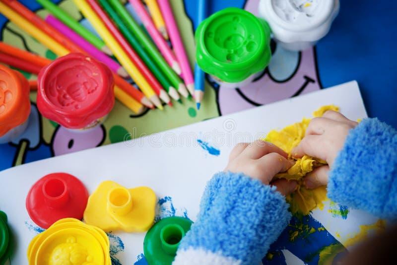 Creation. Child hands modelling plasticine closeup royalty free stock image