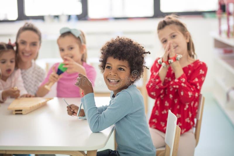 During creation. Children in kindergarten royalty free stock image