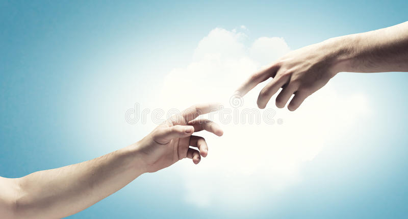 Creation concept. Close up of human hands touching with fingers stock photography