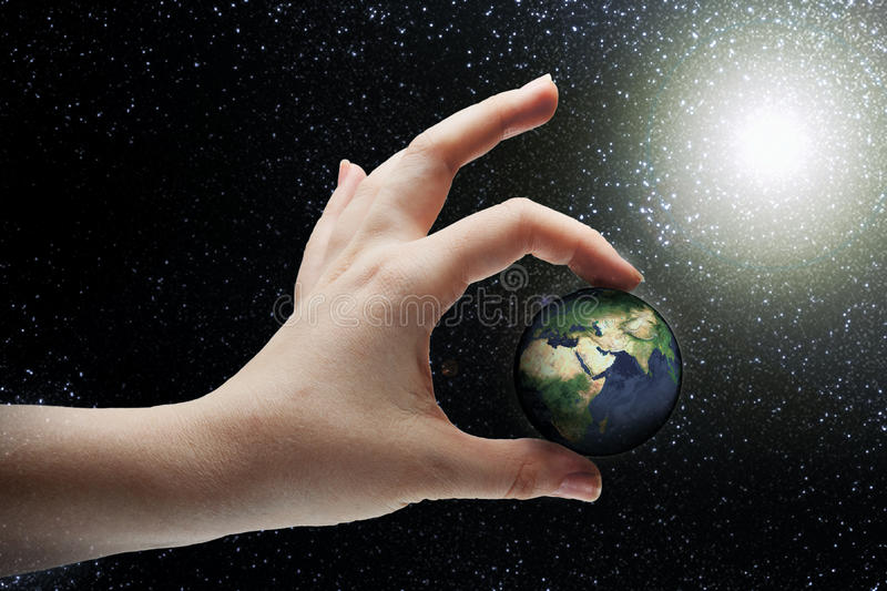 Creation. Female hand holding planet Earth royalty free stock photography