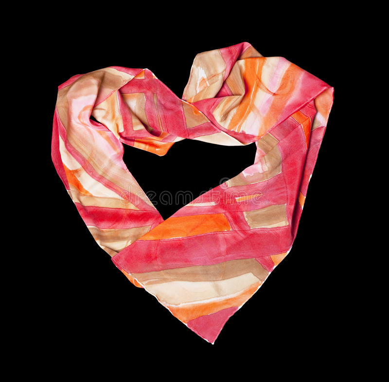Creation from silk scarf. Heart made from silk scarf on black isolated stock photography