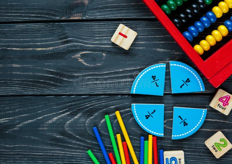 Creative Ð¡olorful math fractions on dark background. Interesting funny math for kids. Education, back to school concept royalty free stock photography