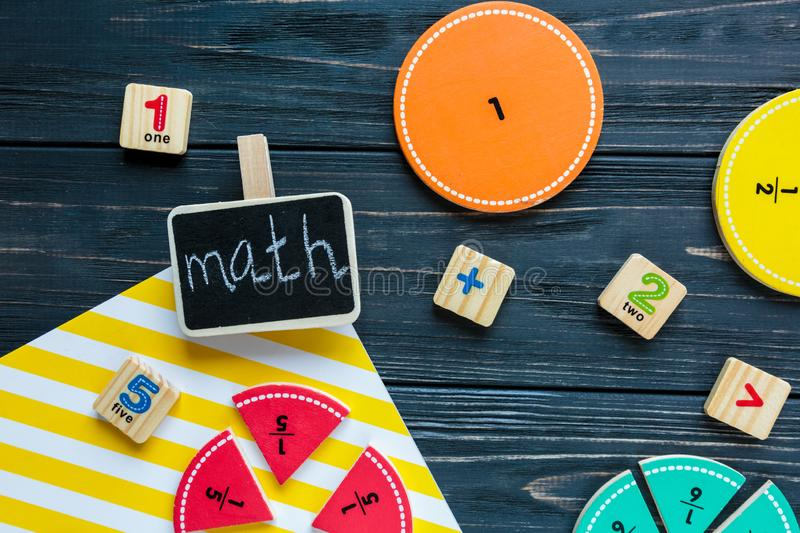 Creative Ð¡olorful math fractions on dark background. Interesting funny math for kids. Education, back to school stock images
