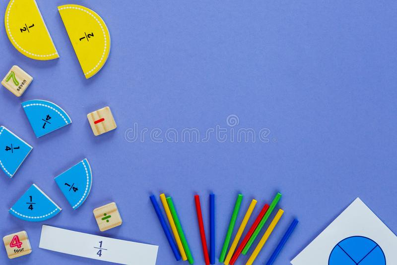 Creative Ð¡olorful math fractions on violet background. Interesting funny math for kids. Education, back to school stock photos