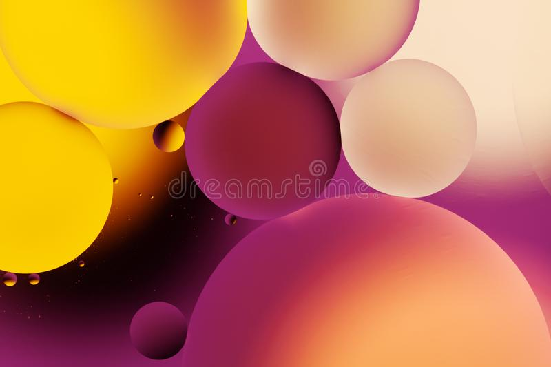 Creative abstract background with colorful drops in water, macro. Molecule and atom biotechnology design. Planets in space. And universe art abstraction royalty free stock image