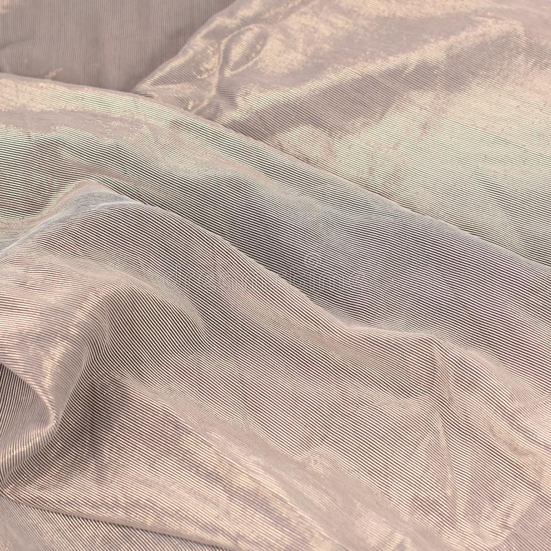 Creative abstract background of folded brown cloth. royalty free stock image