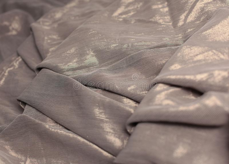 Creative abstract background of folded brown cloth. stock photo
