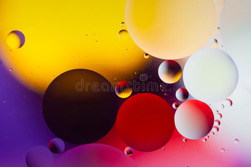 Creative abstract background with liquid transparent drops in water, macro. Molecule and atom biotechnology design. royalty free stock photos