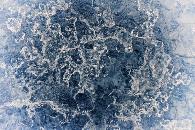 Creative abstract blue frozen background of melting ice surface. Closeup Creative abstract blue frozen background of melting ice surface royalty free stock images