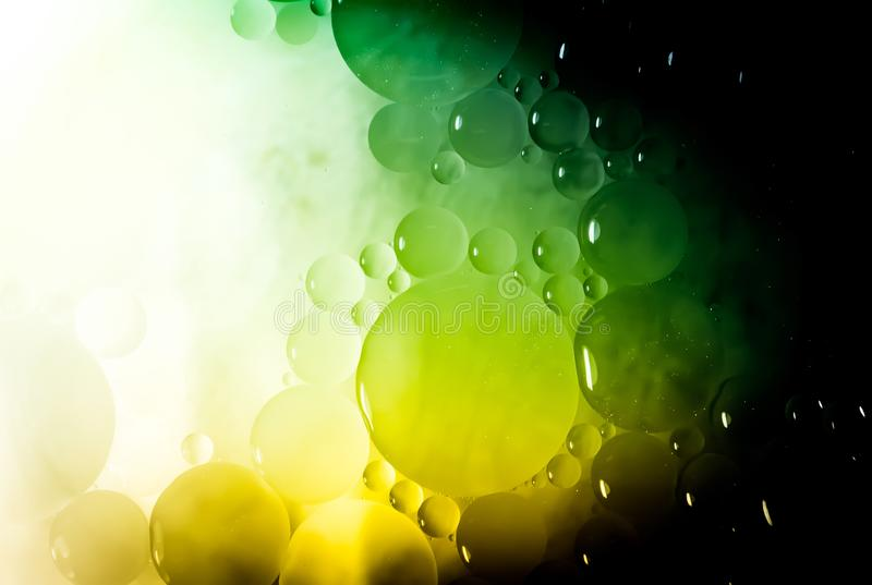 Creative abstraction background from circles of different sizes with backlight and gradient in green and yellow color.  royalty free stock photo