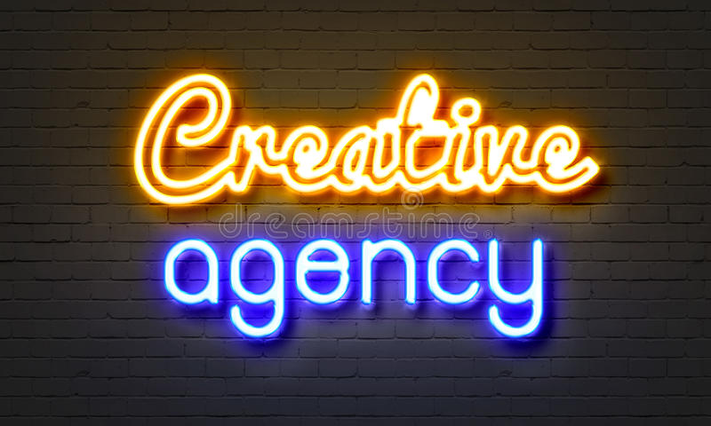 Creative agency neon sign on brick wall background. Creative agency neon sign on brick wall background stock image