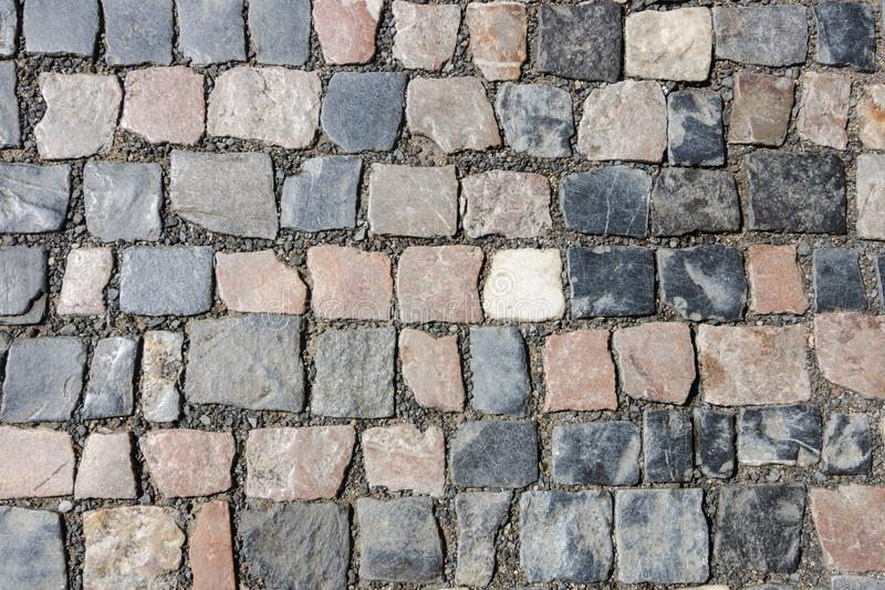 art background of fine granite tiles for street pavement stock photography