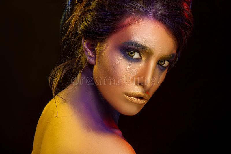 Creative art makeup. Close-up studio portrait of young fashion m. Odel on a black background stock photo