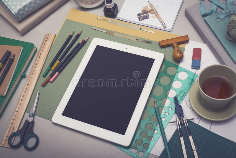Creative artist desk tablet PC mockup royalty free stock images