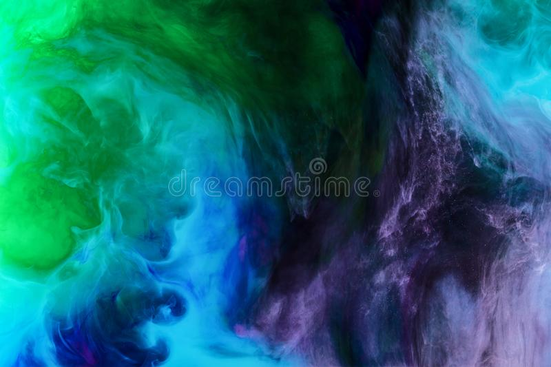 Creative background with blue, purple and green paint swirls looks like space royalty free stock image