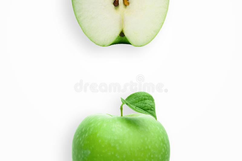 Creative background, green apple and slices of apple on a white background. Flat lay, copy space, layout. The concept of nutrition. Creative background, green stock image