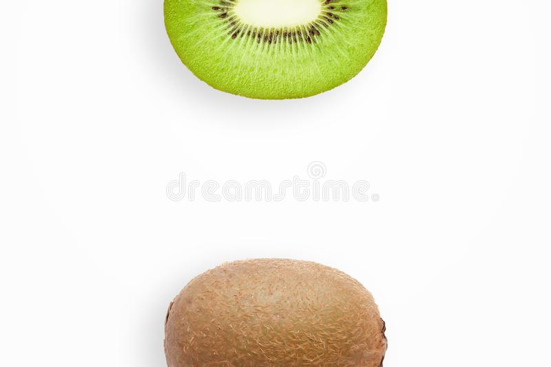 Creative background, kiwi and kiwi slices on a white background. Flat lay, copy space, layout. The concept of nutrition, fresh. Creative background, kiwi and stock image