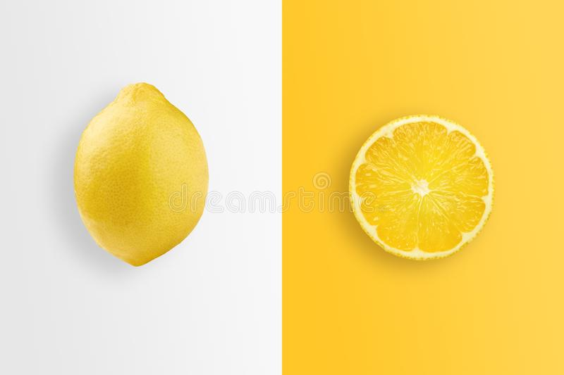 Creative background, lemon and lemon slices on a white and yellow background. Flat lay, copy space. The concept of nutrition,. Creative background, lemon and stock image