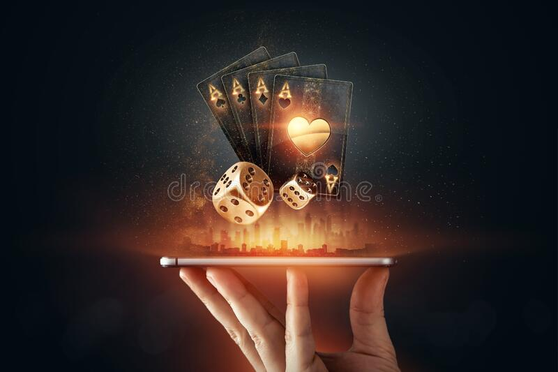 Creative Background, Online Casino, In A Man`s Hand A Smartphone With  Playing Cards, Roulette And Chips, Black-gold Background. Stock Image -  Image of betting, cards: 197363135