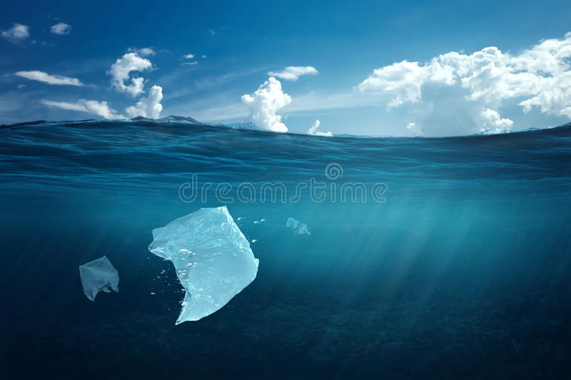 Creative background, plastic bag floating in the ocean, a bag in the water. The concept of environmental pollution, non- stock photography