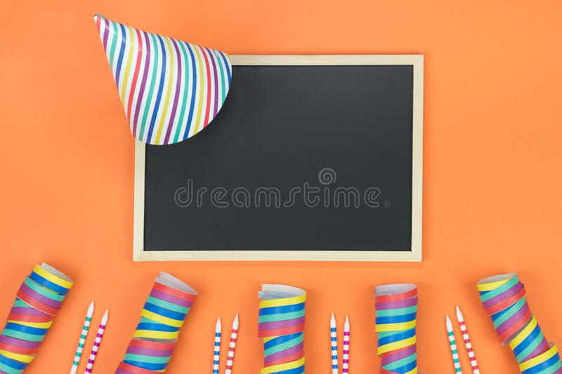 Creative birthday party decoration on orange background. Top vie. W with frame and space for text royalty free stock photography