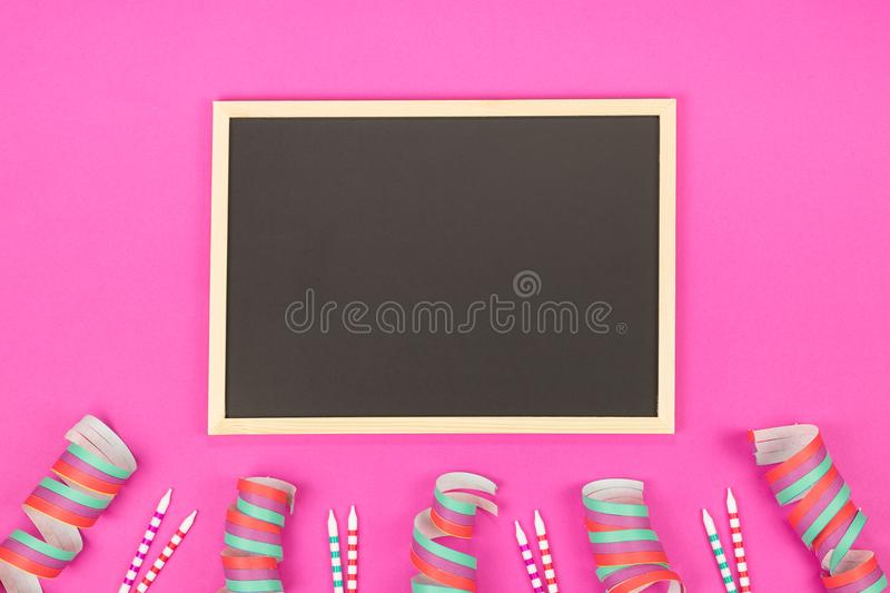 Creative birthday party decoration on pink background. Top view stock photo
