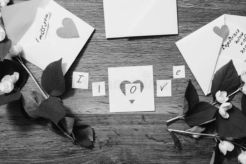 Creative black and white photography. Black and white art photography monochrome, inscription `I miss you. I love you. I am happy,` writing on the envelope stock images