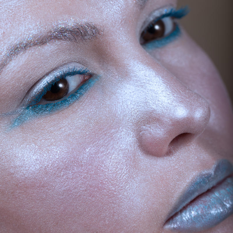 Creative blue make-up. Close-up of a creative blue make-up royalty free stock image