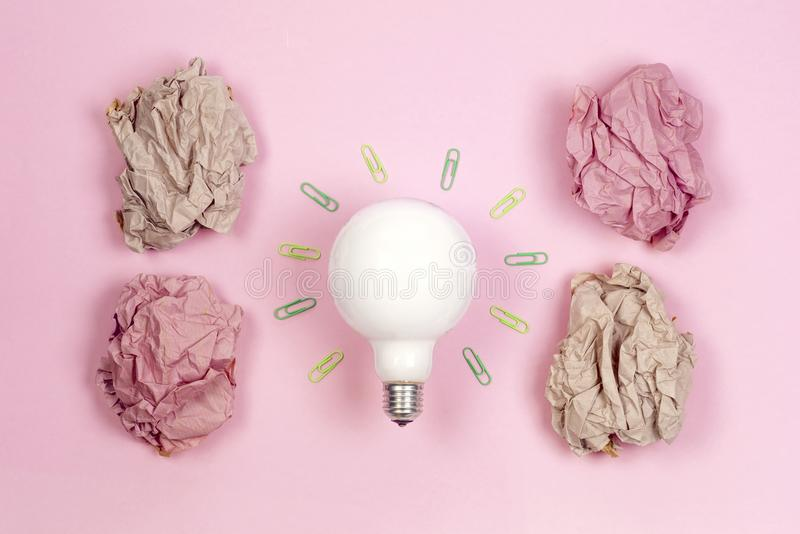 Great idea concept with crumpled colorful paper and light bulb o stock images