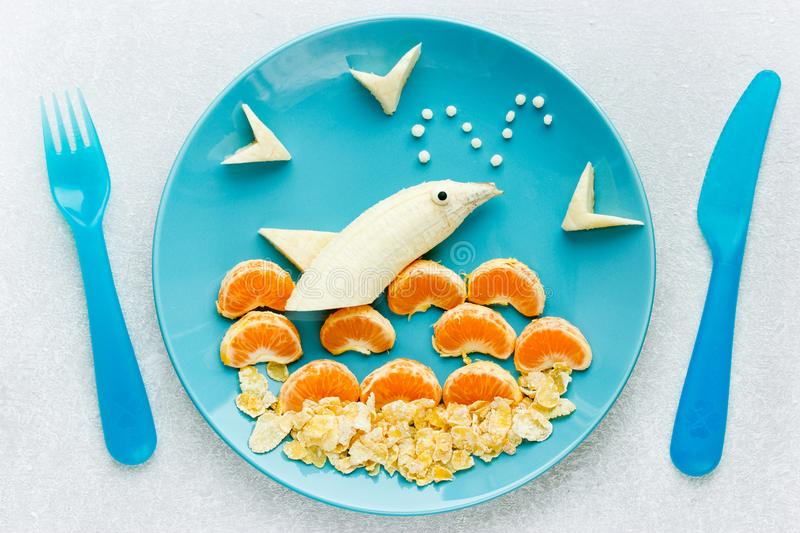 Creative breakfast or dessert idea for kids banana dolphin royalty free stock images