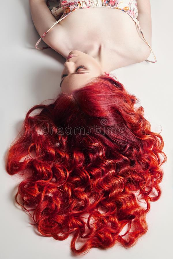 Creative bright coloring of a woman`s hair, careful care of the hair roots. Bright dye for coloring, long strong hair. Natural stock image