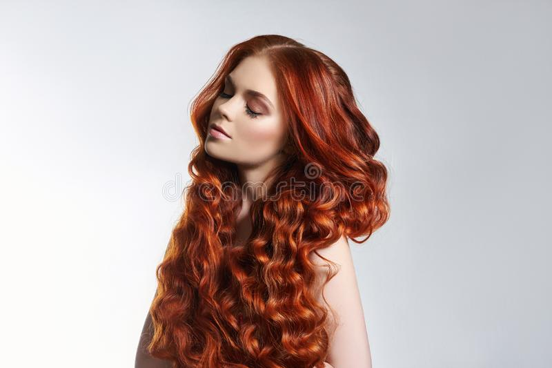 Creative bright coloring of a woman`s hair, careful care of the hair roots. Bright dye for coloring, long strong hair. Natural royalty free stock photo