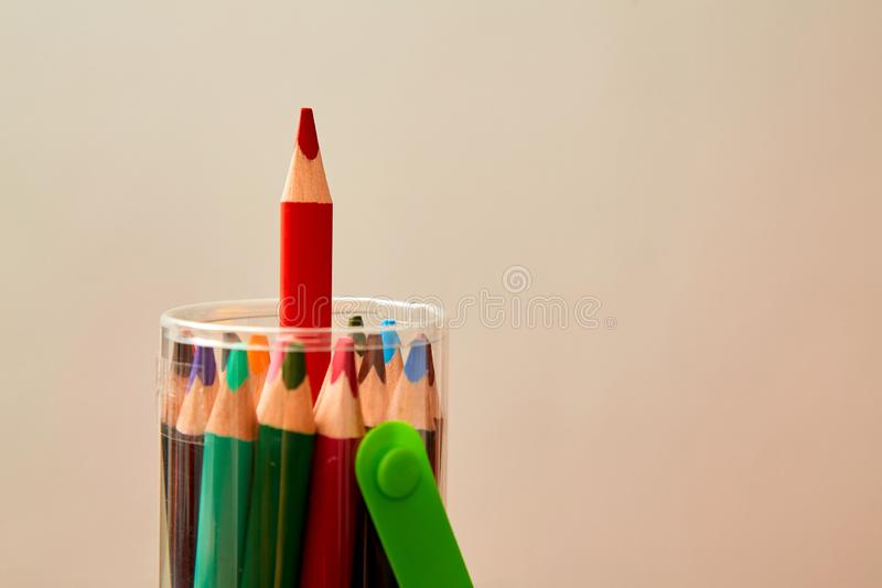Creative, bright idea and innovation or inspiration concept. Colored pencil sticking out of the pack stock photos