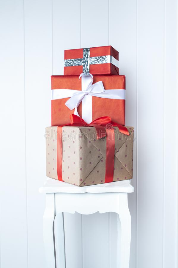 Creative, bright photo minimalism, one-on-one gift boxes on a white wall background. Gift and Presentation Symbol, New Year,. Bright photo minimalism, one-on-one royalty free stock image