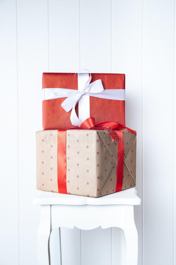 Creative, bright photo minimalism, one-on-one gift boxes on a white wall background. Gift and Presentation Symbol, New Year,. Valentine`s Day, Birthday stock photography
