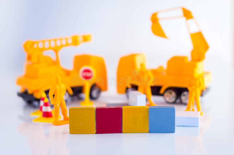 Creative business concept with light bulb and workmen figure. And truck toys stock photography