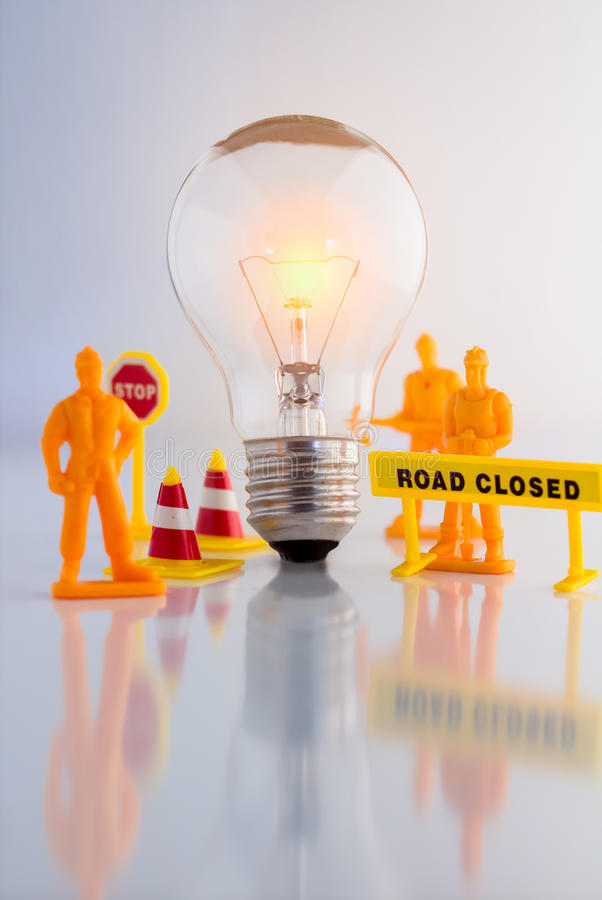 Creative business concept with light bulb and workmen figure. And truck toys royalty free stock images