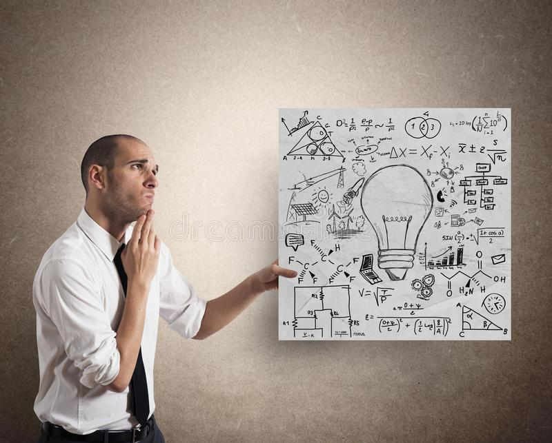 Creative business idea. Businessman with Creative business idea on a paper sheet royalty free stock images